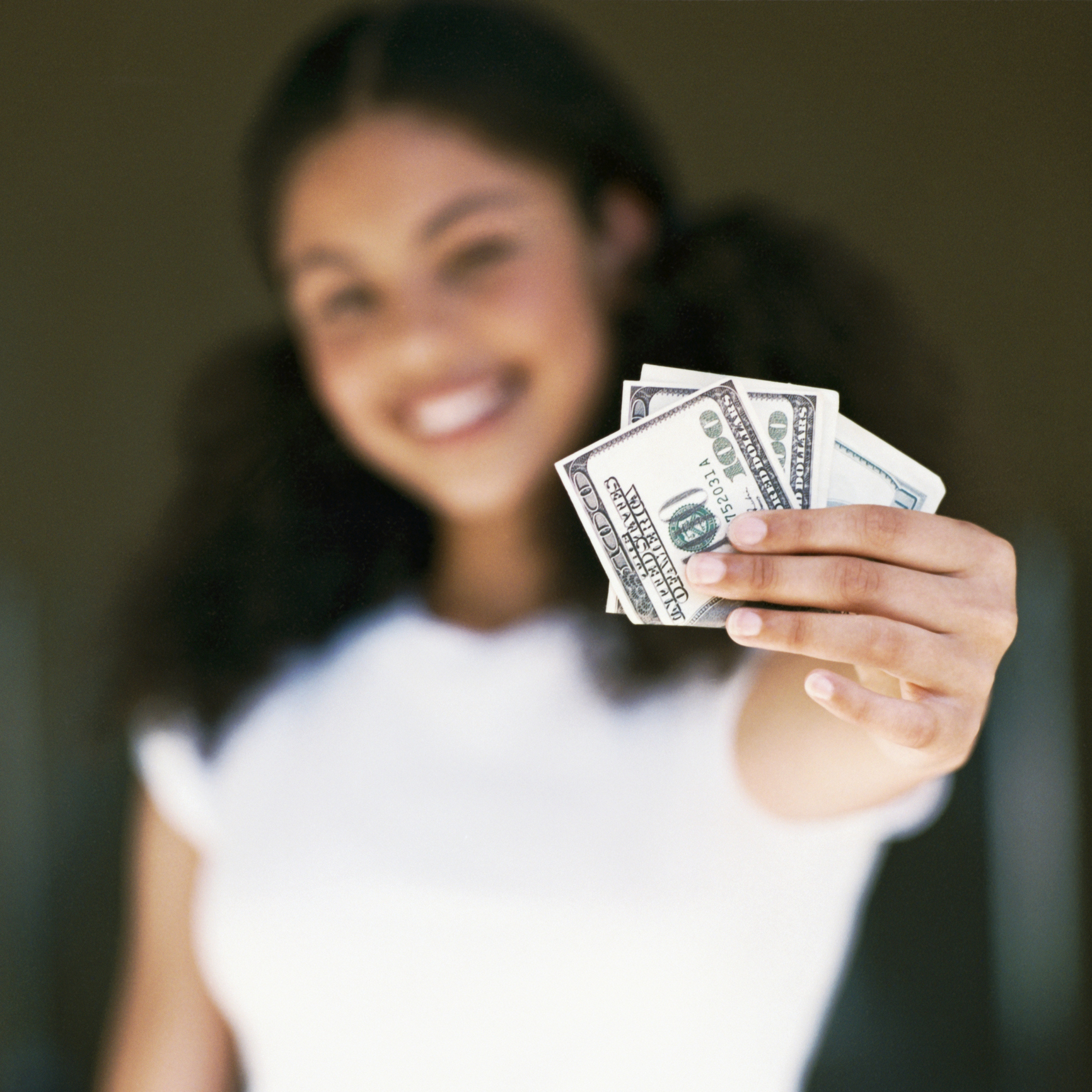Woman holding US currency