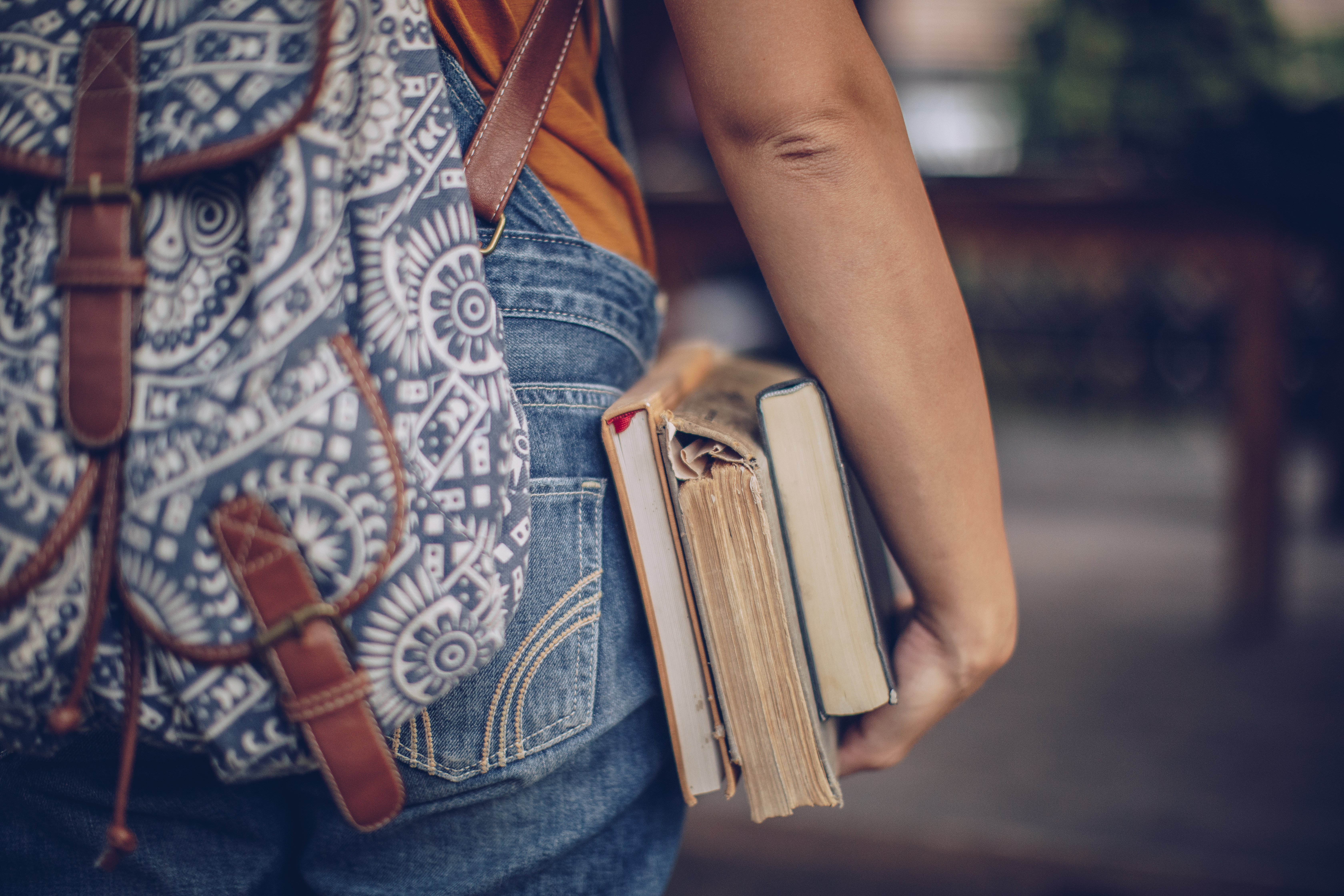Woman student holding book