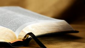 Open Bible on Gold Background