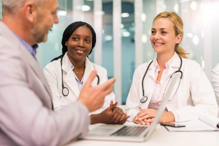 Young female doctors having a meeting with businessman.