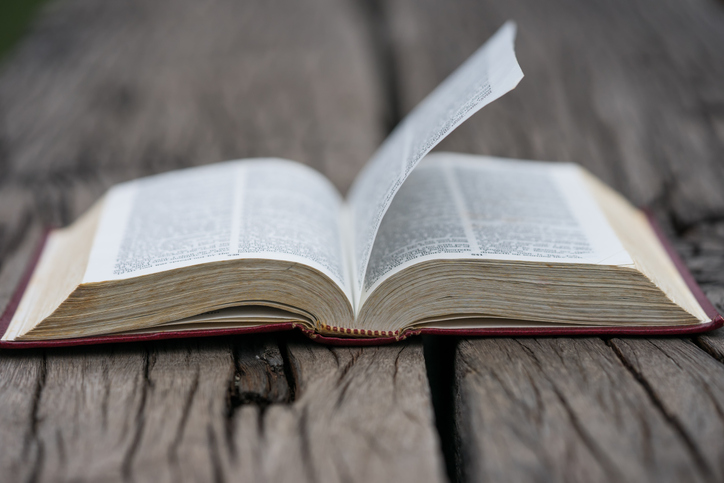 Open bible on wood background