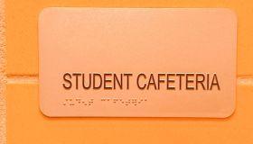 school cafeteria sign including braille alphabet