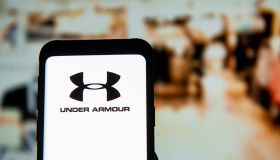 In this photo illustration an Under Armour logo seen...